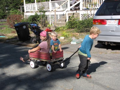 Harvey pulling Mama and Zion in the wagon.. he's working hard!