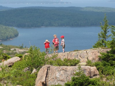 the three boys on a distant outcropping, Eagle Lake behind them