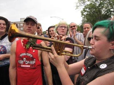a trumpet player amidst the crowd