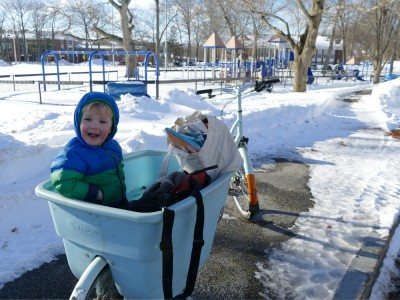 Lijah in the cargo bike in the snow