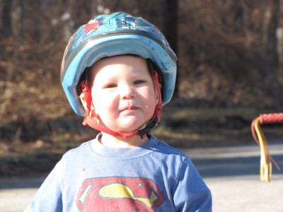 Lijah out on the street in bike helmet and t-shirt