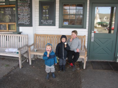 three boys enjoying cones in front of Bedford Farms