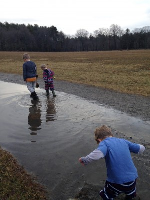 the boys walking through a giant puddle