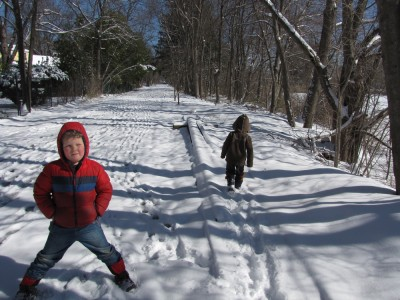 the boys walking along the snowy bike path