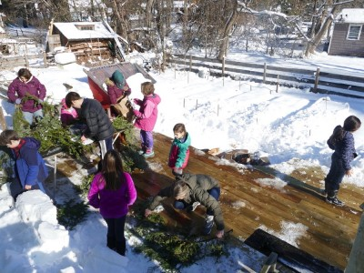 kids and adults making wreathes on our back deck