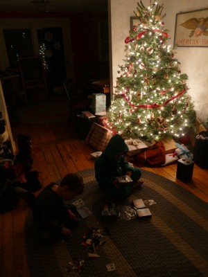 Zion and Lijah building legos by the light of the Christmas tree