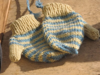 close-up of the yellow and blue striped mittens