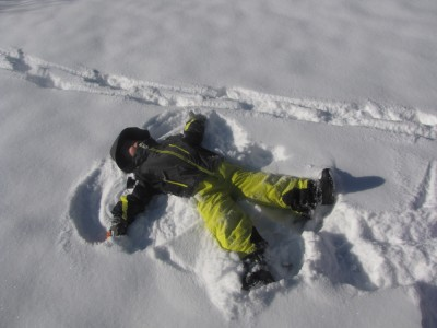 zion making a snow angel