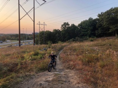 Zion biking up a hill at sunrise