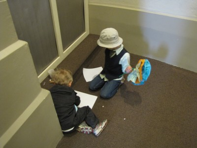 Zion and Eliot drawing together in a quiet corner