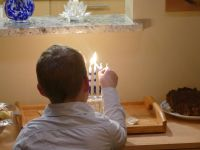 Zion lighting the Hannukah candles