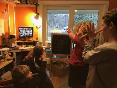 our family dancing in the playroom to a folk-dance caller on the computer