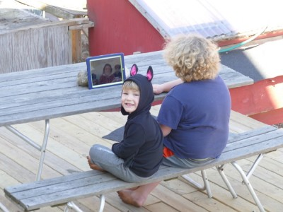 Harvey and Lijah on a Zoom call on the iPad on the back deck